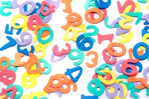Colourful numbers scattered on white